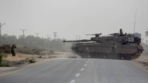 Israeli tanks maneuver at the Israeli-Gaza Strip border.
