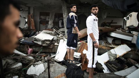 Palestinians stand on the rubble of the demolished home of Ezzedine Haddad, commander of the armed wing of the Hamas movement, the Ezzedine al-Qassam Brigades, that was destroyed by an Israeli airstrike in Gaza City on Saturday, November 17. Israeli air strikes in Gaza killed 10 Palestinians, five of them militants, as nine Israelis were hurt by rocket fire, four of them soldiers, medics said.