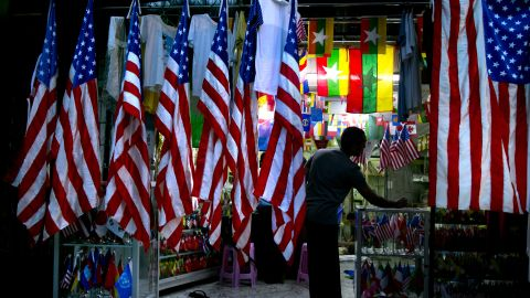 A Burmese worker is seen in a flag shop surrounded by American flags on Friday in Yangon.