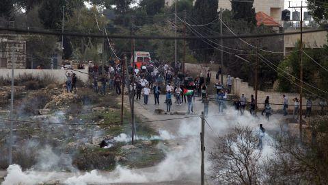 Birzeit University students clash with Israeli soldiers on Monday.