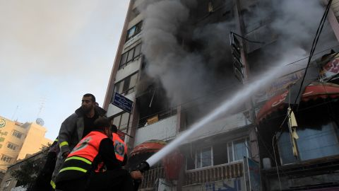 Palestinian firefighters extinguish a blaze following an Israeli airstrike in a Gaza City tower housing Palestinian and international media on Monday.