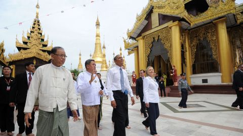 U.S. President Obama (3rd L) and U.S. Secretary of State Hillary Clinton (front R) are escorted around the grounds as they visit the Shwedagon pagoda in Yangon on Monday.
