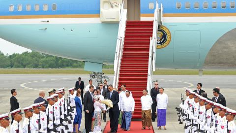 U.S. President Obama is greeted by a contingent at the Yangon International airport on Monday.