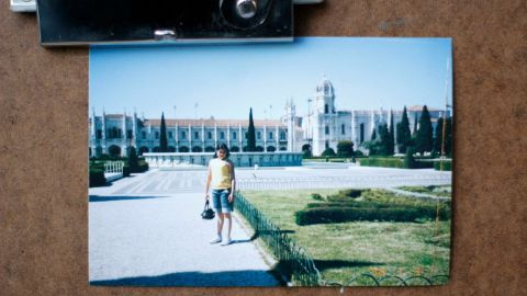 A youngster is snapped in front of a grand building in this photograph, lost after Superstorm Sandy.