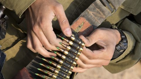 Israeli soldiers from a tank squadron prepare ammunition at an Israeli army deployment area on Monday.