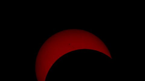 """""""The photograph I uploaded is approximately 17-18 minutes past the peak of the eclipse. The reason I chose that photo is because it shows a few Sun spots, and it's not just a solid block of reddish colour like those I took closer to the peak,"""" says <a href=""""http://ireport.cnn.com/docs/DOC-882137"""" target=""""_blank"""">Goran Ristic</a> from Auckland, New Zealand."""