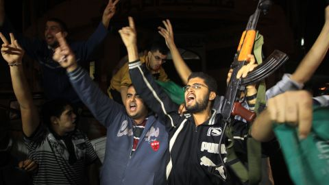Palestinians celebrate news of the cease-fire with Israel in Gaza City on Wednesday, November 21.