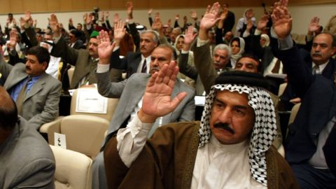 Members of Iraq's parliament vote in 2002. Luxurious mustaches became ubiquitous during Saddam Hussein's rule, but have been seen as a symbol of high social status since Ottoman times.