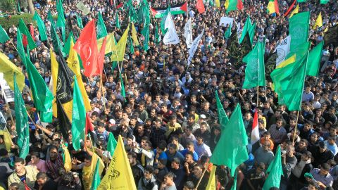 Palestinians gather to listen to Hamas Prime Minister Ismail Haniyeh speak Thursday in Gaza City. Supporters of Hamas and its moderate rival Palestinian party Fatah displayed rare unity in celebrating the cease-fire.