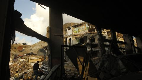 Palestinians inspect the rubble of a destroyed house in Gaza City on Friday.