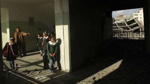 Palestinians school girls walks along a corridor of their school in Gaza City on Saturday.