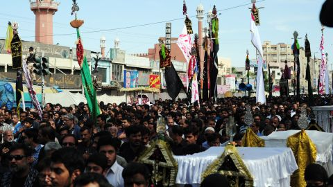 Pakistani Shiite Muslims march during a religious procession on the ninth day of holy month of Moharram in Karachi.