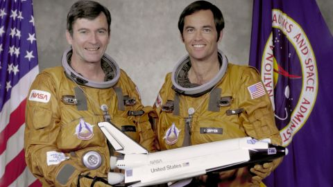 Columbia made the first orbital flight of NASA's space shuttle program on April 12, 1981. Here, crew members John Watts Young, left, and Robert Laurel Crippen hold a model of the orbiter in 1979.