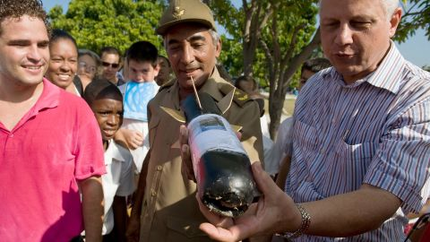 Gen. Arnaldo Tamayo Mendez, center, looks at a homemade rocket in Havana, Cuba, in 2009. Mendez became the first Latin American, the first person of African descent and the first Cuban to fly in space when he flew aboard the Soviet Soyuz 38 on September 18, 1980.