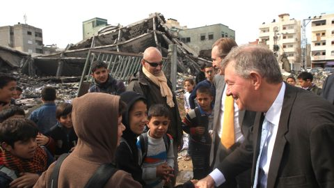 Robert Serry, the United Nations Special Coordinator for the Middle East Peace Process, greets children during a visit to Gaza to survey damage caused by the exchange of fire between Israel and Hamas militants, on Sunday, November 25.