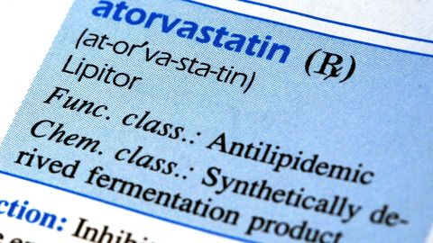 """DES PLAINES, IL - OCTOBER 12:  Information regarding Lipitor, know as Atorvastatin in the pharmaceutical world, is seen in Mosby's """"Nursing Drug Reference"""" book October 12, 2005 in Des Plaines, Illinois. The manufacturer of Lipitor, Pfizer, will appeal any possible Lipitor patent rulings regarding generic manufacturing of the company's cholesterol drug.  (Photo by Tim Boyle/Getty Images)"""
