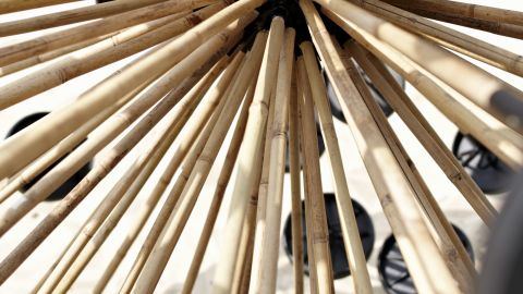 A multitude of plunger-like arms made from lightweight bamboo spread out from a spherical core that contains a cheap GPS tracking device. The Mine Kafon can withstand the loss of about a third of these arms before it can no longer propel itself forward by the wind.