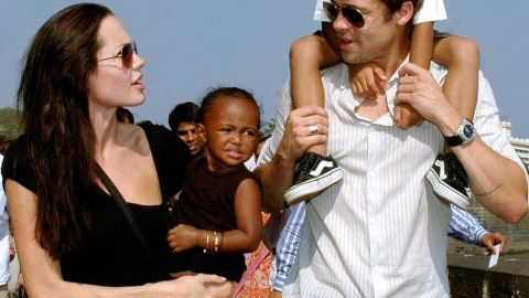"""Brad moved to adopt Zahara and Maddox toward the end of 2005, officially making them Jolie-Pitts. Here, the family walks along the seafront promenade in Mumbai, where Jolie was filming """"A Mighty Heart,"""" a project Pitt produced."""