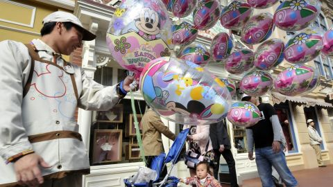 Picture taken on April 15, 2011 shows a balloon seller at the Tokyo Disneyland greeting visitors at Urayasu city, suburban Tokyo.