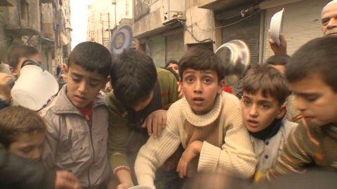 Children fight for food in Aleppo _00001605