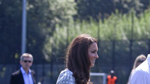 """Also on July 26, she and Prince William visited Bacon's College in London. The grey and white Hobbs dress she wore <a href=""""http://www.fabsugar.com.au/Kate-Middletons-88-Hobbs-Dress-Has-Sold-Out-s-Still-Cute-Snoop-Her-Olympics-Style-from-All-Angles-24173205"""" target=""""_blank"""" target=""""_blank"""">sold out quickly.</a>"""
