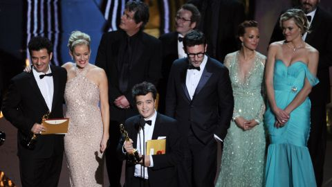 """<strong>February 26: </strong>Surrounded by the cast and crew, producer Thomas Langmann accepts the best picture award for """"The Artist"""" during the 84th Annual Academy Awards in Hollywood. The silent, black-and-white film garnered five Oscars."""