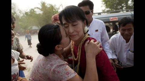 <strong>April 1: </strong>A supporter kisses Aung San Suu Kyi, leader of the National League for Democracy, as she visits polling stations in her constituency as Burmese vote in parliamentary elections in Kawhmu, Myanmar. She won a seat in parliament in Myanmar's first multiparty elections since 1990.