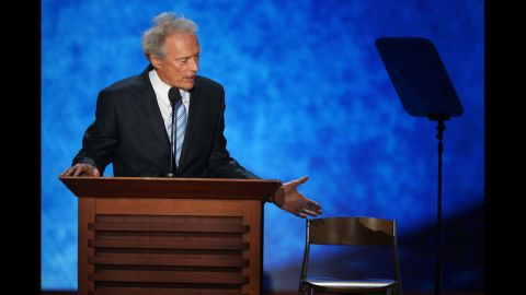 """<strong>August 30: </strong>Actor Clint Eastwood speaks on the final day of the Republican National Convention in Tampa, Florida. During his speech, he addressed an """"invisible"""" President Barack Obama sitting in an empty chair."""