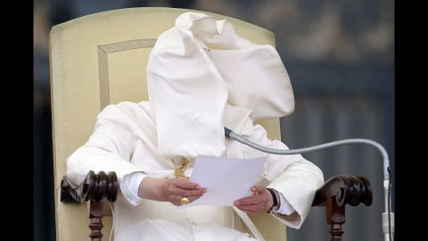 <strong>September 26: </strong>A gust of wind blows Pope Benedict XVI's cloak into his face in St. Peter's Square in Vatican City. Days later, the pope's former butler, Paolo Gabriele, was convicted of aggravated theft for leaking confidential papal documents. He was sentenced to 18 months in prison.