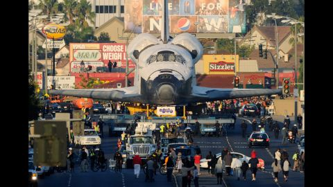 <strong>October 12: </strong>Space Shuttle Endeavour is transported to The Forum arena for a stopover and celebration in Inglewood, California. The space shuttle was on 12-mile journey from the Los Angeles International Airport to the California Science Center to go on permanent public display.