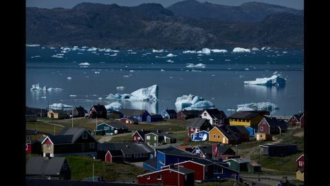 <strong>July 23:</strong> Icebergs from nearby glaciers float in the bay in Narsaq, Greenland.