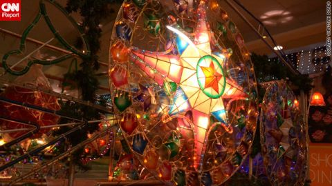 """Christmas lanterns known as 'parols' light up many a Filipino mall, home or street, as seen in <a href=""""http://ireport.cnn.com/docs/DOC-887174"""">this image</a> by Christian Bordo. They were created in 1928 by an artisan to help villagers find their way to churches to pray."""