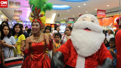 """A wacky Christmas parade with dancers, mascots and of course <a href=""""http://ireport.cnn.com/docs/DOC-889604"""">Santa Claus</a> caught iReporter Patricia Garcia's eye during a shopping trip to a local mall."""