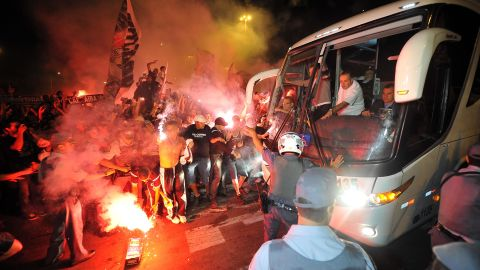 Brazilians are passionate about football. Here Corinthians supporters cheer their team's players at at the Cumbica International Airport in Sao Paulo before their departure to December's FIFA Club World Cup in Japan.