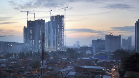 High rise commercial buildings under construction and residential houses are seen in Indonesia's capital city of Jakarta at dawn on February 8, 2012. Indonesia said its economy grew at the fastest rate for 15 years in 2011, spurred by strong household consumption and private investment in Southeast Asia's biggest economy. The country, which has become a magnet for foreign money, posted a 6.5 percent rise in gross domestic product in 2010, the quickest pace since the 1997-98 Asian financial crisis, putting it on track to hit the government's 6.7 percent forecast for this year. AFP PHOTO / ROMEO GACAD (Photo credit should read ROMEO GACAD/AFP/Getty Images)