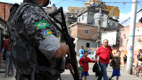 The Brazilian government has implemented programs to control violence in shantytowns around the country. Here an officer patrols one of Rio de Janeiro's favelas.