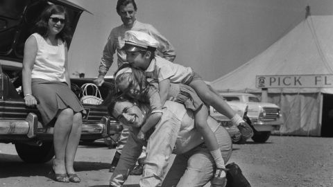 """Former world champion Jackie Stewart, seen here playing with the children of F1 rival Graham Hill, was remarkably friendly with his peers, Tu says. """"He was incredibly fond of a number of people who drove with him. That partly is because there was a clearer distinction of him being a number one and them being number two drivers."""""""