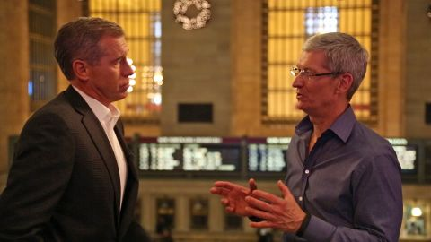 Apple CEO Tim Cook, right, chats with NBC News' Brian Williams outside the Apple store in New York City's Grand Central Station.