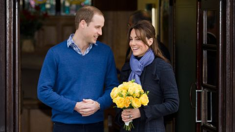Britain's Prince WiIliam, the Duke of Cambridge, (L) poses for pictures with his wife Catherine, Duchess of Cambridge, as they leave the King Edward VII hospital in central London, on December 6, 2012.