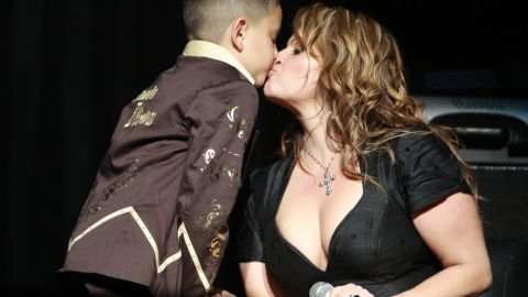 The singer kisses her son during a July 2009 concert in Los Angeles.