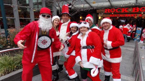 """<a href=""""http://ireport.cnn.com/people/gregreesehd"""">Greg Reese</a> photographed these costumed attendees of Santacon 2012 in Cincinnati, Ohio. """"It's an annual event where they dress up like Santa and other holiday icons and walk around the city giving candy and [going on] pub crawls,"""" he said."""