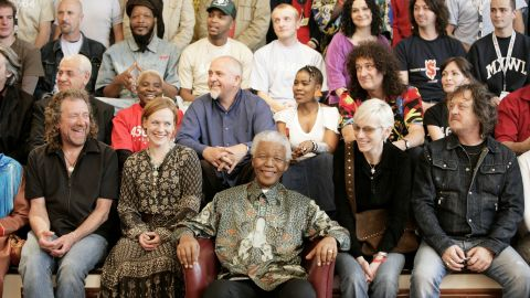 """The """"46664 Arctic"""" benefit concert was held in Tromso, Norway, on June 11, 2005. 46664 was Mandela's identification number in prison. Here, artists who performed at the event surround him."""