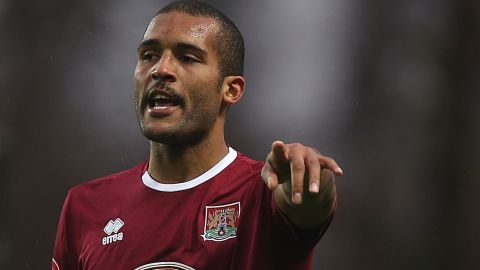 Clarke Carlisle while playing for Northampton Town in 2012.