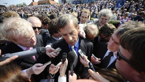 """A media scrum surrounds Frankel's trainer, Henry Cecil. The celebrity racing figure is """"hugely loved"""" by the public, according Bazalgette."""