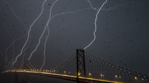 """<a href=""""http://ireport.cnn.com/docs/DOC-890265"""">Phil McGrew</a> kept his camera going for an hour and a half as a storm passed over San Francisco's Bay Bridge in April 2012. He shot this 20-second exposure through a rain-soaked window. """"Lightning is rare here, but I always thought it (the bridge) would be a pretty good target for lightning,"""" he said."""