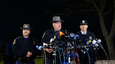 Connecticut State Police spokesman Lt. J. Paul Vance, center, briefs the media on the elementary school shootings during a press conference at Treadwell Memorial Park on December 14, in Newtown.