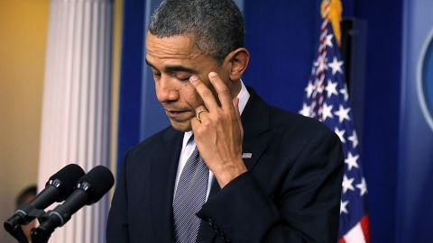 Obama wipes tears as he makes a statement in response to the shooting on Friday.