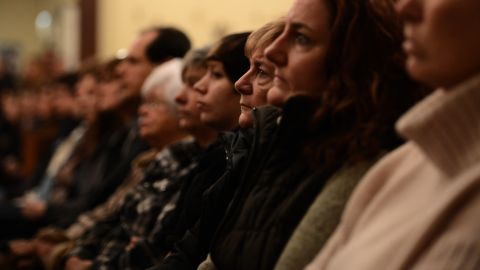 People gather in the St. Rose Church for a memorial service Friday.
