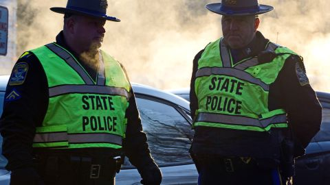 Police stand guard at the entrance to the Sandy School on December 15, 2012 in Newtown, Connecticut.