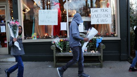 Flowers and signs of sympathy adorn the street leading to Sandy Hook Elementary School.